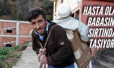 Babasını sırtında taşıyor